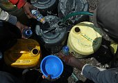 AMBASU Residents fetch water in small bottles and jerrycans on March 22 2012 in the Mathare slum in Nairobi In a bid to boost access to clean water...