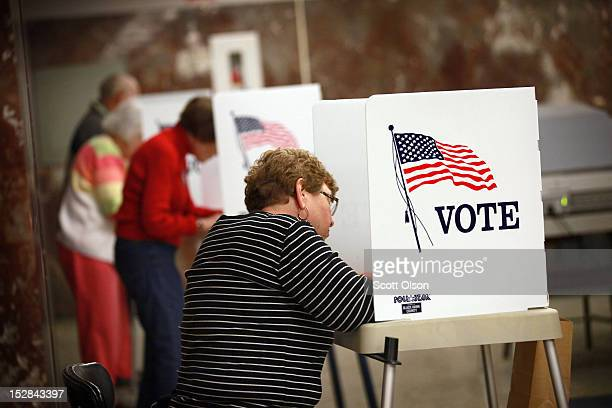 Residents fill in their ballots during early voting at the Black Hawk County Courthouse on September 27 2012 in Waterloo Iowa Early voting starts...