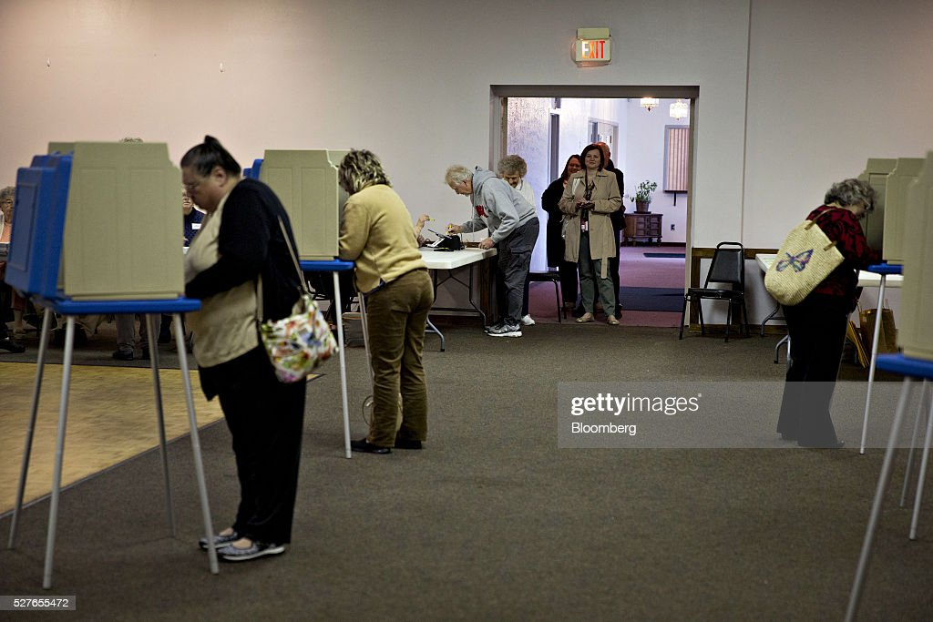 Residents fill out ballots at a polling station during the presidential primary vote in South Bend, Indiana, U.S., on Tuesday, May 3, 2016. The outcome in Indiana, where balloting across two time zones will end at 7 p.m. Eastern time, could yield a deciding moment as the presidential race enters the home stretch. Photographer: Daniel Acker/Bloomberg via Getty Images
