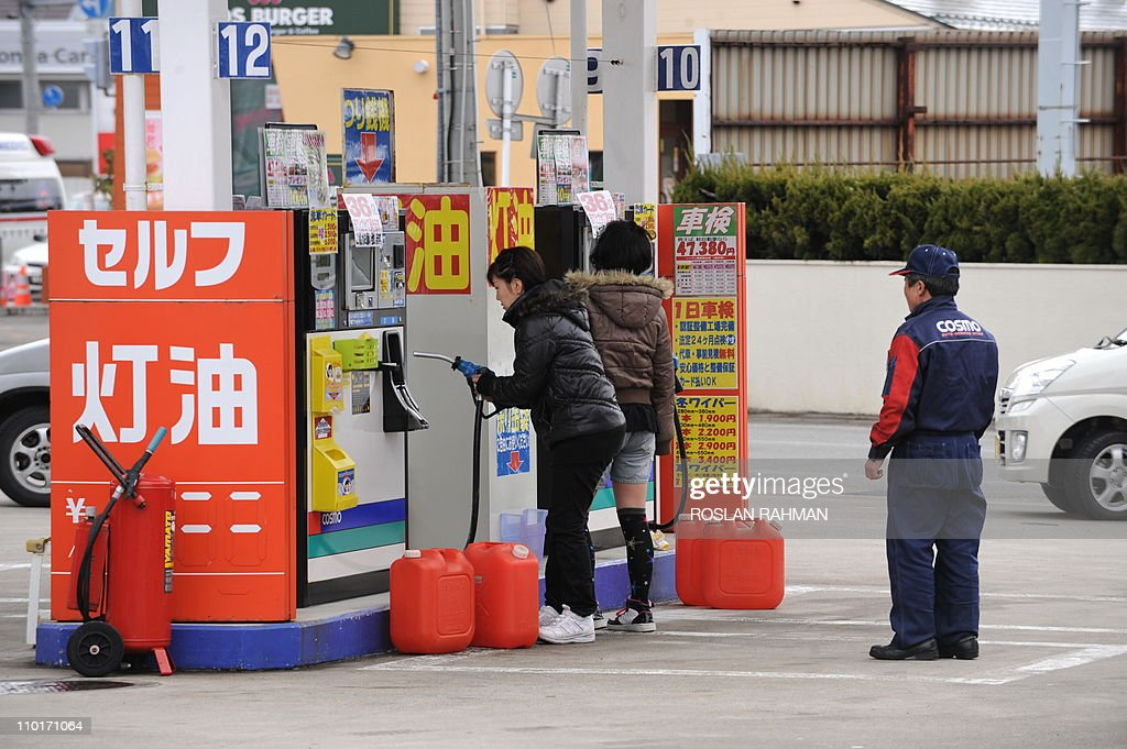 Residents fill up jerrycans with gasoline at a petrol station in Akita, northwestern Japan on March 16, 2011. Japan's nuclear crisis deepened March 16 with another fire at a quake-hit atomic power plant and a radiation spike there that forced the temporary evacuation of workers.