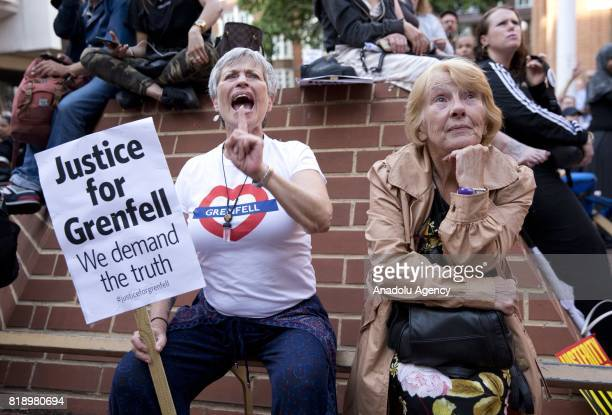 Residents from Grenfell Tower watch a council meeting on a screen outside Kensington and Chelsea Town Hal west London England on July 19 2017 Today...
