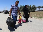 Residents from the city of Ramadi who fled their homes on May 16 2015 as Islamic State group militants tightened their siege on the last government...