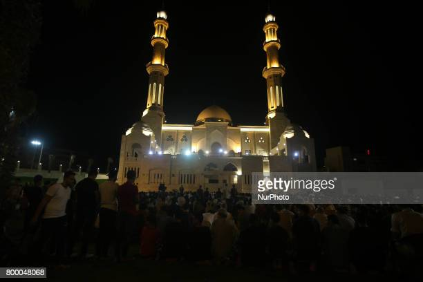 Residents gather around AlHassayna Mosque while waiting for Laylat alQadr prayers on the 27th day of the holy fasting month of Ramadan at the coast...