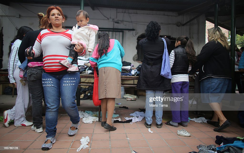Residents gather at a clothing fair put on by the Virgin of the Miracles of Caacupe church in the Villa 21-24 slum, where archbishop Jorge Mario Bergoglio, now Pope Francis, used to perform charity work, on March 15, 2013 in Buenos Aires, Argentina. The fair offers affordable clothing to local residents. Francis was the archbishop of Buenos Aires and is the first pope to hail from South America. Some locals are now affectionately calling Francis, known for his charity work in the slums, the 'slum pope.'