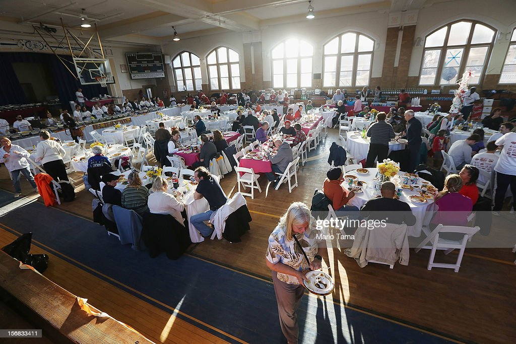 Residents gather for a free Thanksgiving dinner at St. Francis de Sales Parish in the Rockaway neighborhood on November 22, 2012 in the Queens borough of New York City. A number of organizations are providing free Thanksgiving meals for residents of the Rockaways which was hard hit by Superstorm Sandy.