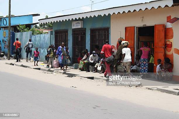 Residents gather in the streets after a series of explosions at a munitions depot in the Congolose capital of Brazzaville on March 4 2012 'We count...