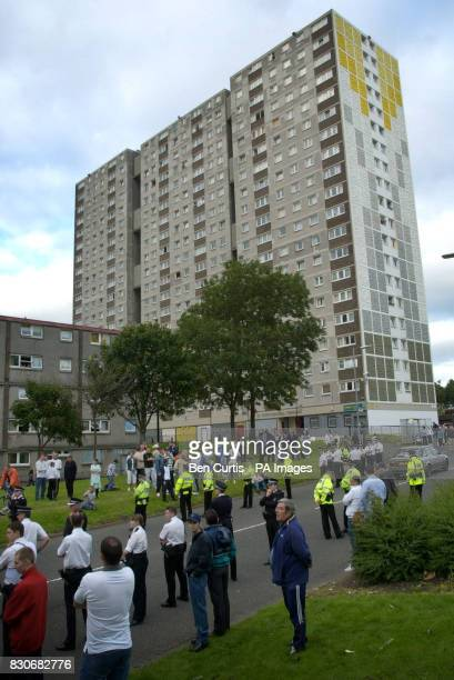 Residents gather on the street as racial tensions rise in the Sighthill district of Glasgow following the death of a Turkish man Police launched a...