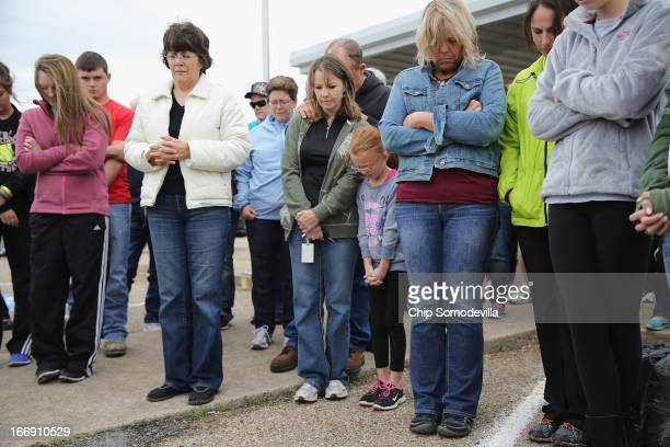 Residents gather outside the West Community Center to pray for the victims and survivors the day after the West Fertilizer Company explosion April 18...