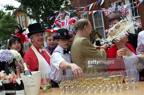 Residents get drinks as they take part in a street party organised by residents of Battersea in south London on June 2 as Britain celebrates Queen...