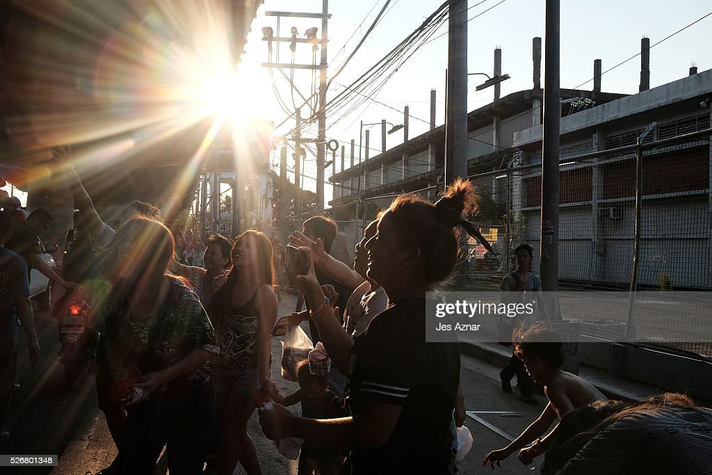 Residents go out in the streets of Manila to show their support for presidential candidate Rodrigo Duterte during a campaing event on May 1, 2016 in Manila, Philippines. Duterte, the tough-talking mayor of Davao in Mindanao has been the surprise pre-election poll favourite, pulling away from his rivals despite controversial speeches and little national government experience. Opinion polls have shown Mr. Duterte has maintained his lead with 33 percent support with Senator Grace receiving 22 percent. The Philippine presidential elections will be held on May 9, with five candidates vying for the top post.