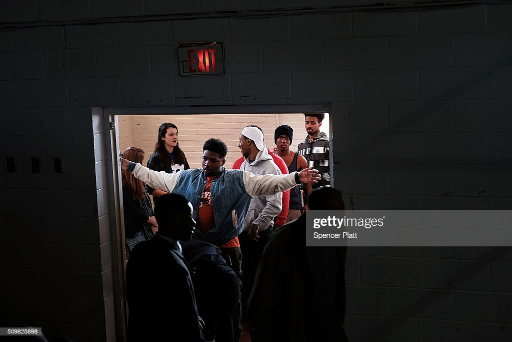 Residents go through security before getting into a school to see Democratic presidential candidate Hillary Clinton speak in South Carolina a day after her debate with rival candidate Bernie Sanders on February 12, 2016 in Denmark, South Carolina. Clinton is counting on strong support from the African American community in South Carolina to give her a win over Sanders in the upcoming primary on February 27.