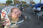 Residents hang out near a tent made from a billboard advertisement in Tent City in Ontario California The City of Ontario opened Tent City for the...