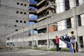 Residents hang their clothes to dry during the peaceful eviciton of the Tower of David an abandoned skyscraper in Caracas which originally intended...