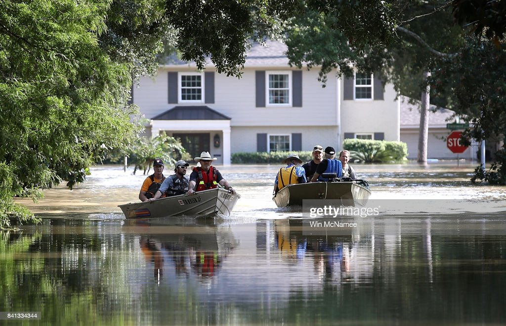 Residents in a neighborhood near the Barker Reservoir return to their homes to collect belongings August 31, 2017 in Houston, Texas. The neighborhoods surrounding the reservoir are still experiencing severe flooding due to the accumulation of historic levels of rainfall, though floodwaters are beginning to recede in many parts of the city.