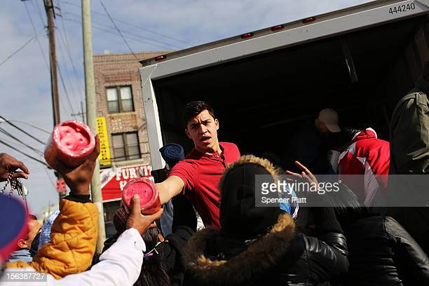 Residents in need are handed out donated items including food and towels from a group called Dream Center in the heavily damaged Rockaway...