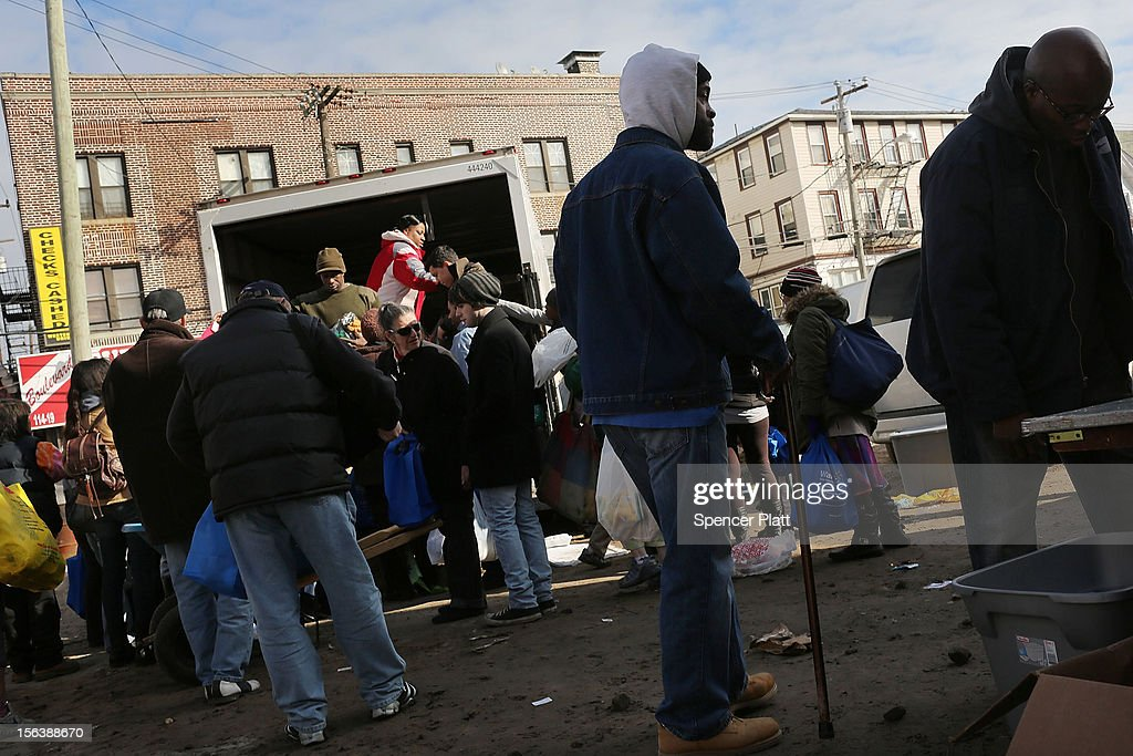 Residents in need are handed out donated items including food and towels from a group called Dream Center in the heavily damaged Rockaway neighborhood where a large section of the iconic boardwalk was washed away on November 14, 2012 in the Queens borough of New York City. Two weeks after Superstorm Sandy slammed into parts of New York and New Jersey, thousands are still without power and heat.
