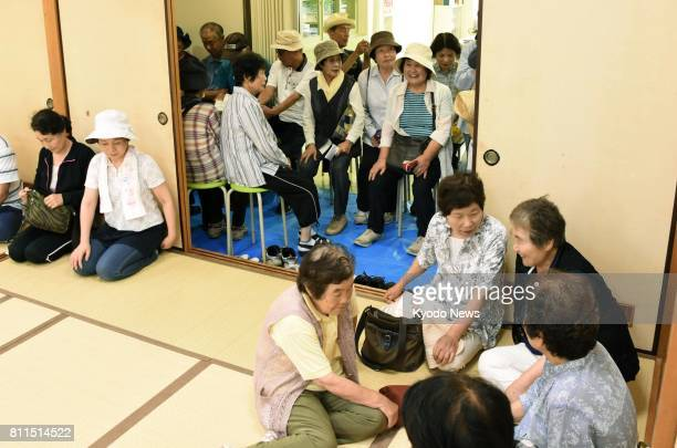 Residents in Saijo Ehime Prefecture in southwestern Japan take part in an evacuation drill on July 10 in the wake of North Korea's repeated...