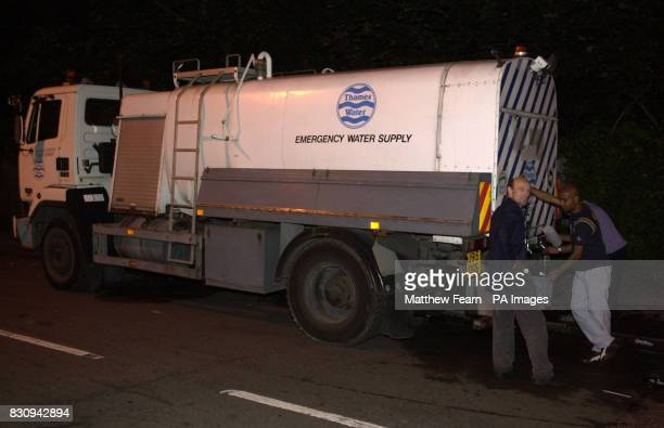 Residents in Streatham south London fill containers from an emergency water supply bowser About 9000 homes were without water supplies tonight after...