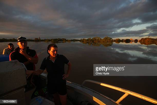 Residents inspect the damage to the area as parts of southern Queensland experiences record flooding in the wake of Tropical Cyclone Oswald on...