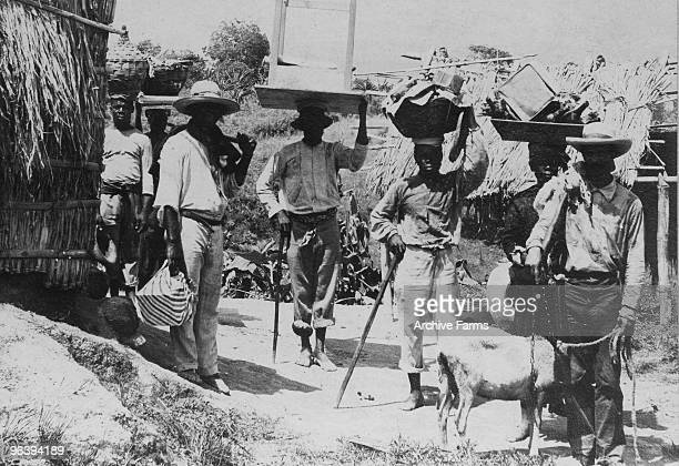 Residents leave home after the eruption of the Mount Pelee volcano to escape its wrath on May 10 1902 at St Pierre Martinique