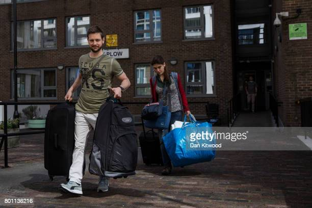 Residents leave their home on the Taplow Block on the Chalcots Estate on June 26 2017 in London England Residents of the Chalcots Estate have been...