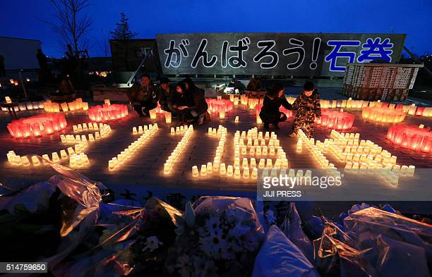 Residents lit candles saying '311 memorial' in Ishinomaki Miyagi prefecture on March 11 2016 Japan pauses on March 11 to mark five years since an...