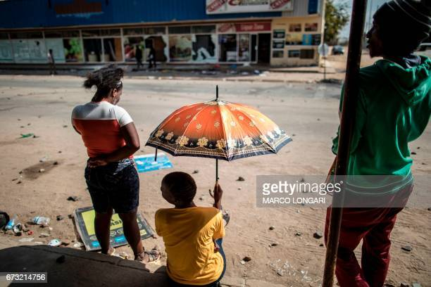 TOPSHOT Residents look a the damages on the main street of Coligny on April 26 2017 The shops on the main street of the North Western Province town...