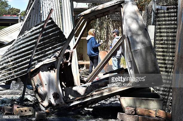 Residents look around their property after it was destroyed during a bushfire in Freeling north of Adelaide on November 26 2015 Hundreds of...