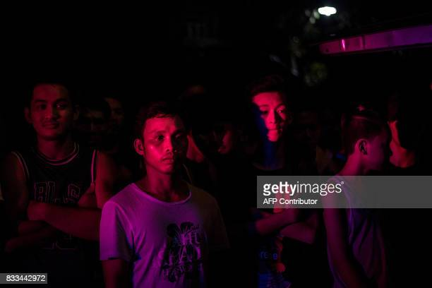 Residents look at a crime scene where an alleged drug dealer was killed during a police antidrug operation in Manila on August 17 2017 Police in the...