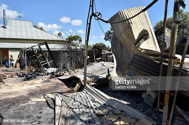 Residents look at damage caused to their property following bushfires in Freeling north of Adelaide on November 26 2015 Hundreds of firefighters...