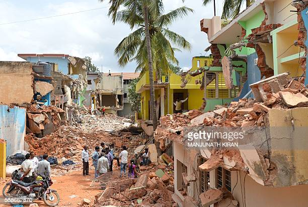 Residents look at the debris of demolished houses a day after Bangalore's municipal authority Bruhat Bengaluru Mahanagara Palike brought down houses...