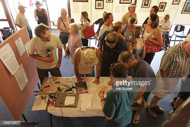 Residents look at updates and maps of the fire at the Evacuation centre on November 24 2011 in Margaret River Australia Over 200 residents from...