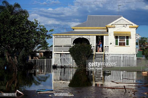 Residents look on as floods suround thier house as parts of southern Queensland experiences record flooding in the wake of Tropical Cyclone Oswald on...