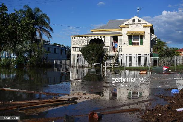 Residents look on as floods suround their house as parts of southern Queensland experiences record flooding in the wake of Tropical Cyclone Oswald on...