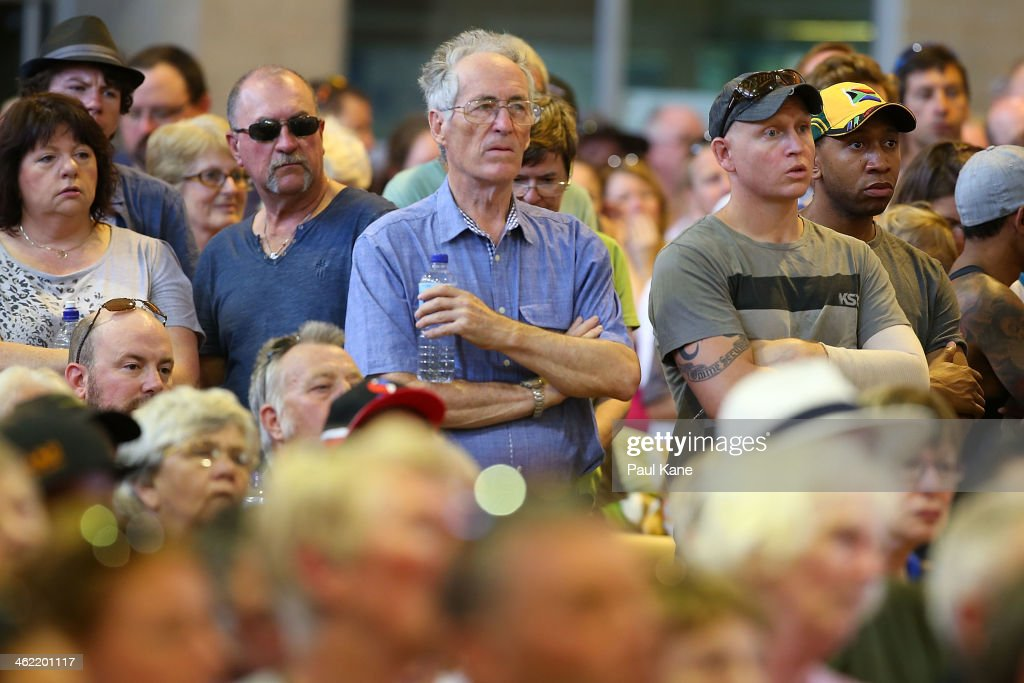 Residents look on during a community meeting to advise home owners of the current fire situation at the Brown Park community centre on January 13, 2014 in Perth, Australia. Evacuated residents of Perth Hills are awaiting permission to access and inspect their properties after a bushfire blazed through the suburb, destroying 46 homes. Emergency services are assessing the affected area and expected the number of properties damaged to increase.