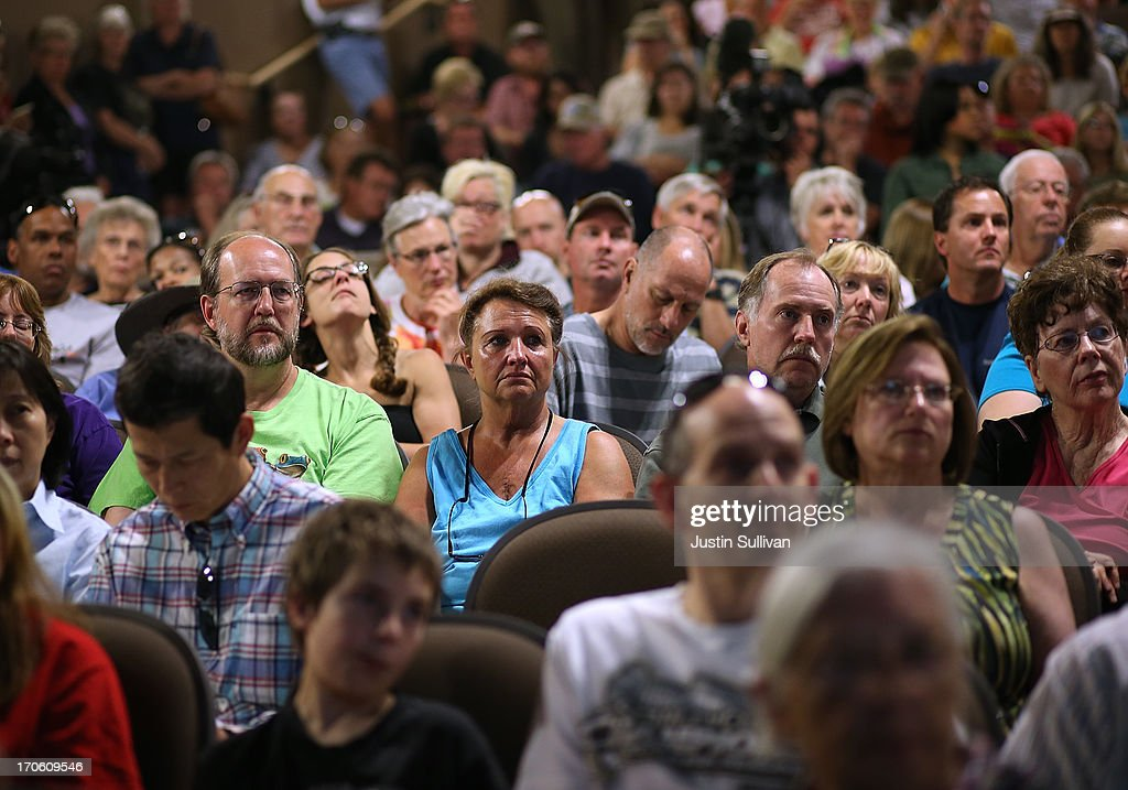 Residents look on during a community meeting to update the status of the Black Forest fire at Palmer Ridge High School on June 15, 2013 in Monument, Colorado. The Black Forest fire is the most destructive in Colorado history, having consumed more than 15,000 acres as of this morning while destroying 473 homes. Two people have died in the fire. .