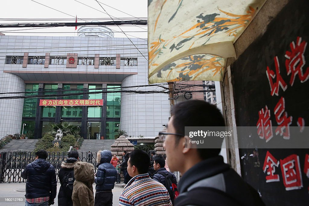 Residents look on outside Guiyang Intermediate People's Court before a press conference on former Chinese leader Bo Xilai's case on January 28, 2013 in Guiyang, China. 'It is fake information. The trial of Bo Xilai will not open in Guiyang today', Vice-president of Guiyang Intermediate People's Court Jiang Hao said. The trial of Bo Xilai is expected to open after the 'two sessions' in March, China's official newspaper Global Times reports on Monday.