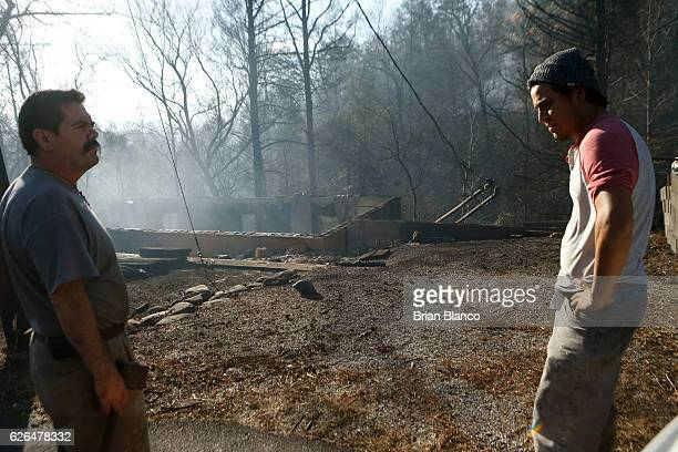 Residents look over the smoldering remains of what had been their twostory condo after a wildfire November 29 2016 in Gatlinburg Tennessee Thousands...