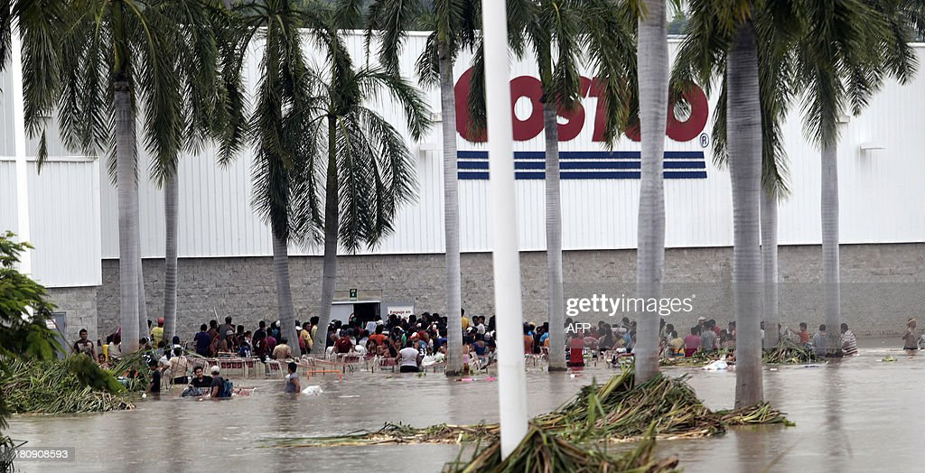 Residents loot a suupermarket in Acapulco, state of Guerrero, Mexico, on September 17, 2013 as heavy rains hit the country. Mexican authorities scrambled Tuesday to launch an air lift to evacuate tens of thousands of tourists stranded amid floods in the resort of Acapulco following a pair of deadly storms. The official death toll rose to 47 after the tropical storms, Ingrid and Manuel, swarmed large swaths of the country during a three-day holiday weekend, sparking landslides and causing rivers to overflow in several states.