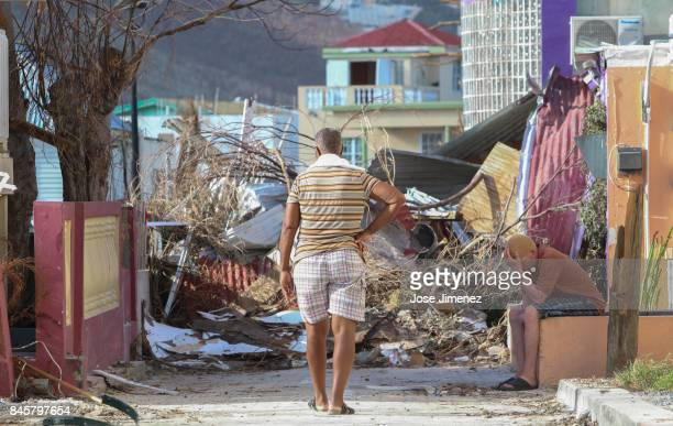Residents observe the damage left by Hurricane Irma on September 11 2017 in Philipsburg St Maarten The Caribbean island sustained extensive damage...