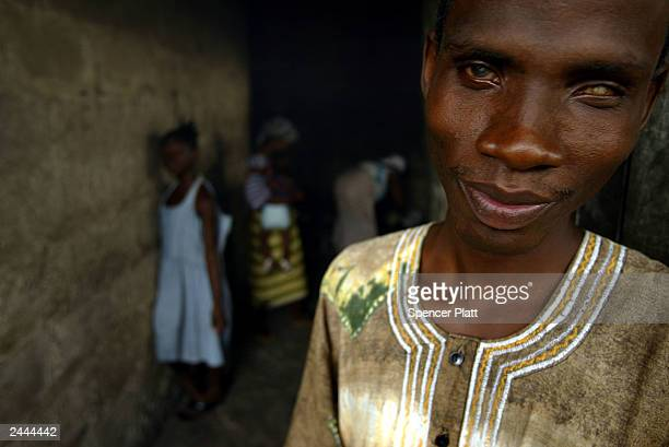 Residents of a community of the blind stand in a doorway August 29 2003 in Monrovia Liberia The blind in Liberia have created communities with other...