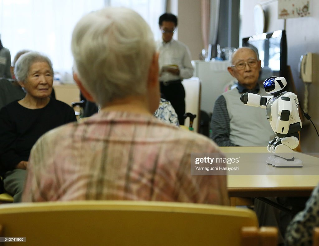 japan health nursing care robots pictures getty images