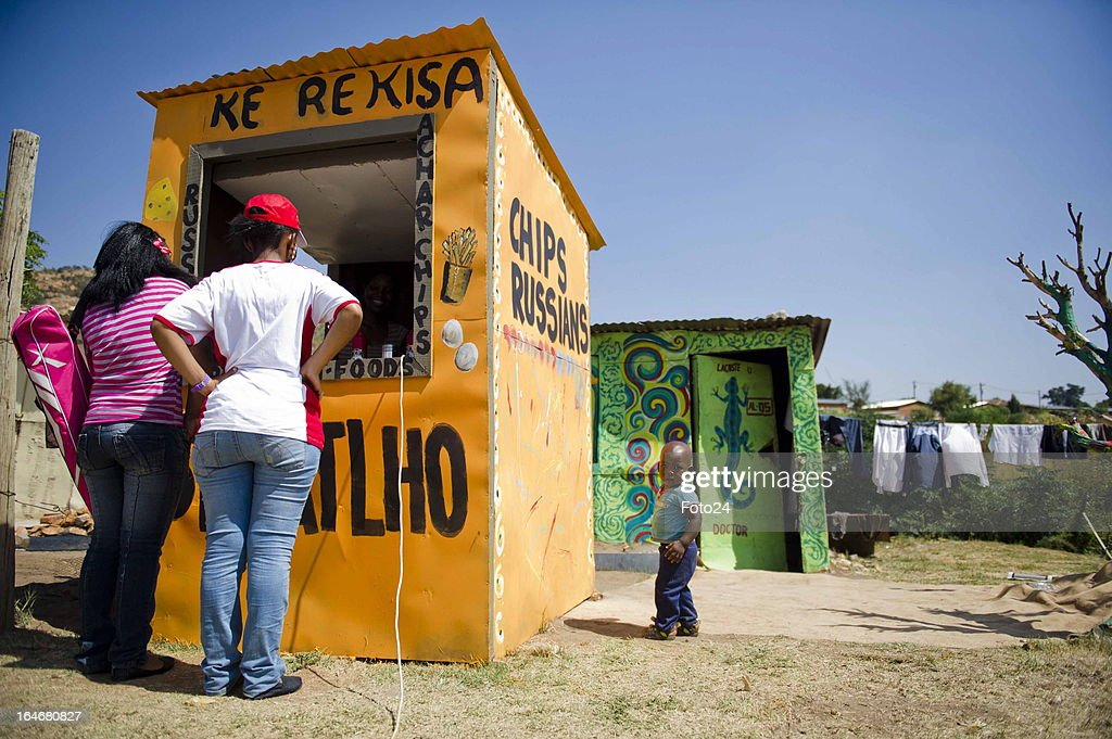 Residents of Alaska Informal settlement on March 24, 2013 in Mamelodi, South Africa. The Viva Foundation hosted the second Mams Art Festival at the informal settlement over the weekend. The art festival focuses on creating the world's first living art gallery by transforming shacks into art work.