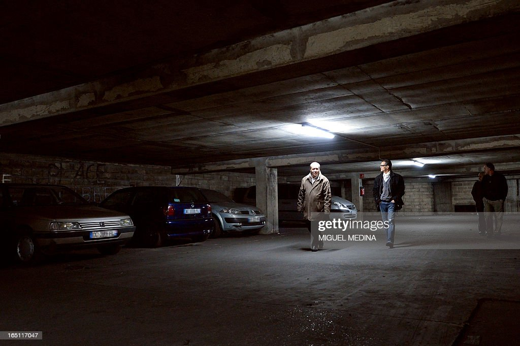 FAURE - Residents of an apparments building patrol in the building's basement to prevent drug dealing, on March 30, 2013 in Epinay-sur-Seine, Paris' suburb.
