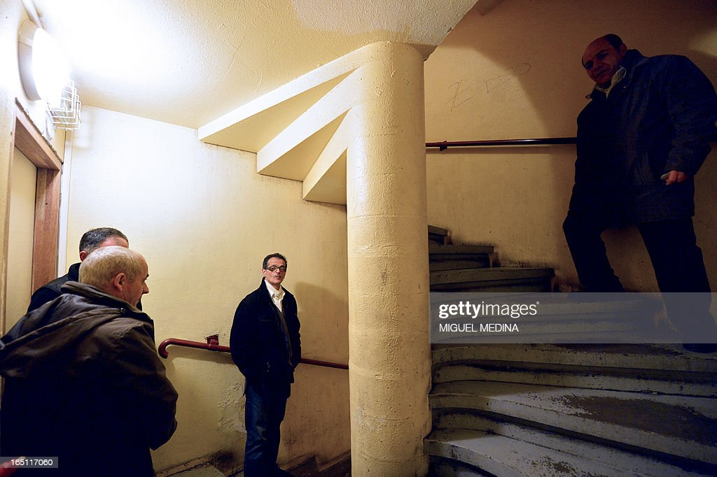 FAURE - Residents of an appartments building patrol in the building to prevent drug dealing, on March 30, 2013 in Epinay-sur-Seine, Paris' suburb.