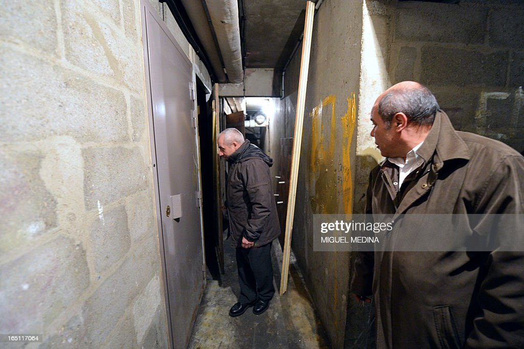 FAURE - Residents of an appartments building patrol in the building's basement to prevent drug dealing, on March 30, 2013 in Epinay-sur-Seine, Paris' suburb.