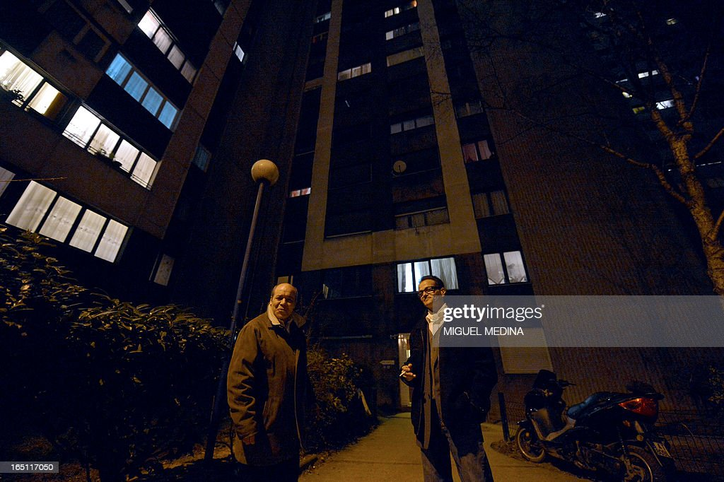 FAURE - Residents of an appartments building patrol outside the building to prevent drug dealing, on March 30, 2013 in Epinay-sur-Seine, Paris' suburb. AFP PHOTO MIGUEL MEDINA
