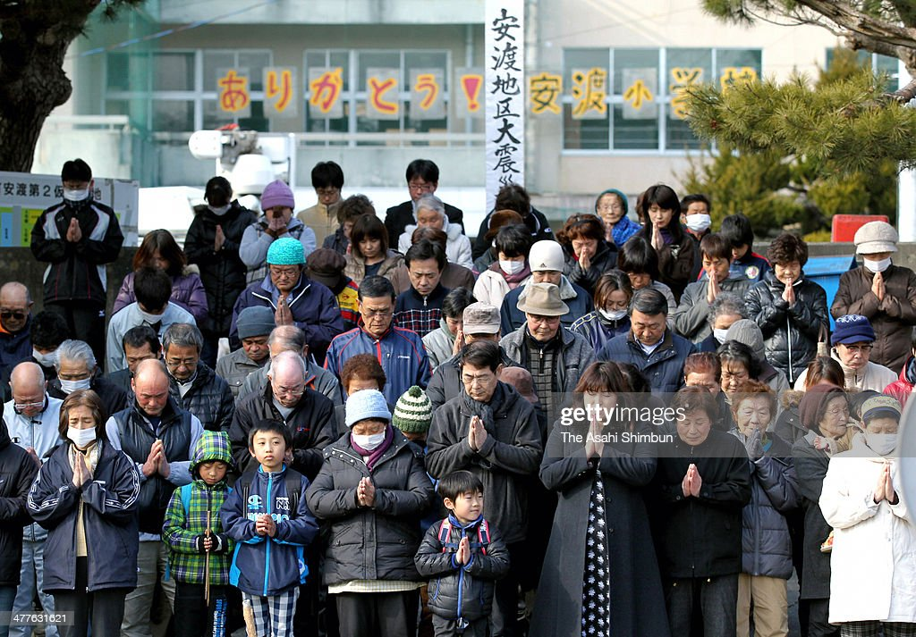 Residents of Ando area observe a minute of silence toward the Pacific Ocean for the victims of the tsunami during a memorial ceremony on March 9, 2014 in Otsuchi, Iwate, Japan. On March 11 Japan commemorates the third anniversary of the magnitude 9.0 earthquake and tsunami.