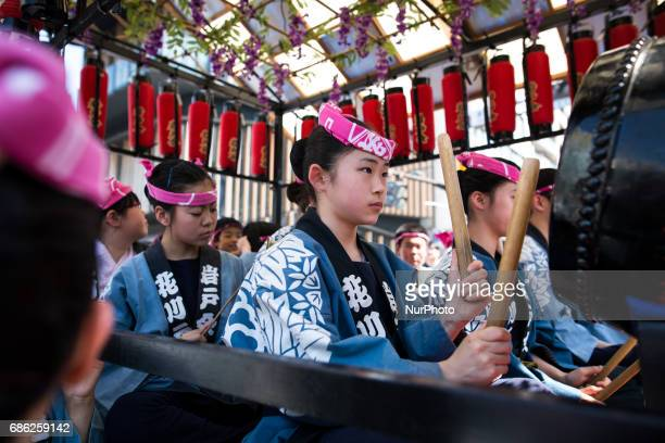 Residents of Asakusa play drums as they parade in the streets of Asakusa during the Sanja Festival in front of in Sensoji Temple in Asakusa Tokyo on...