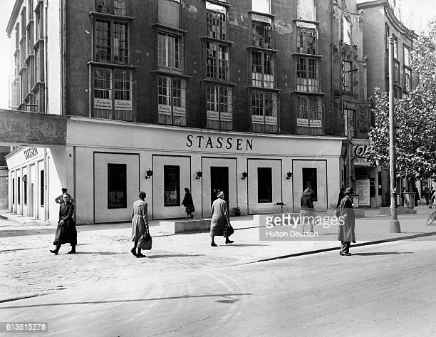 Residents of Berlin walk past the damaged Stassen store on the Kurfurstendamm in 1947
